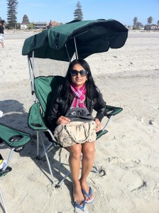 Veena at the beach with her iPad